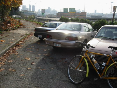 Parked cars block access to bike path